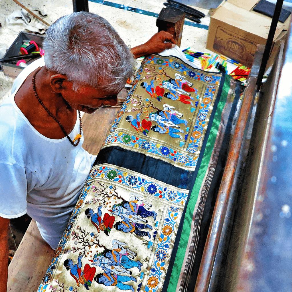 Local-artisan-weaving-silk-India