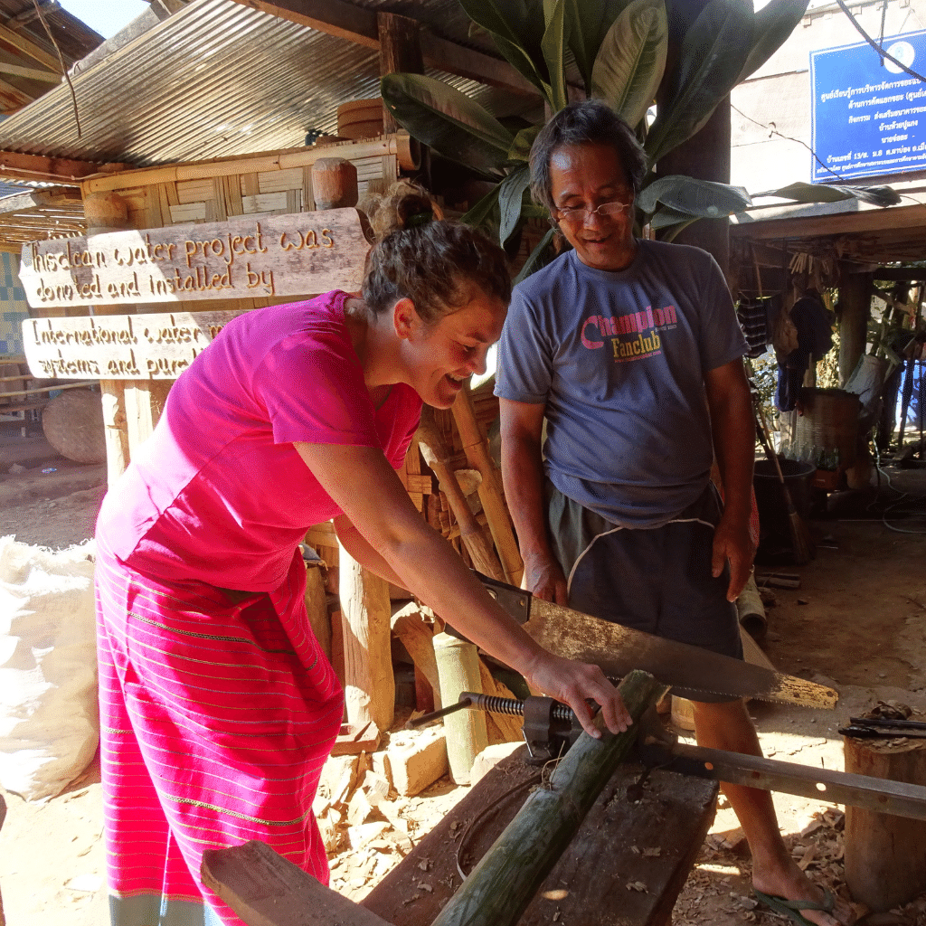 Charlotte doing a bamboo cup making workshop in Huay Pu Keng