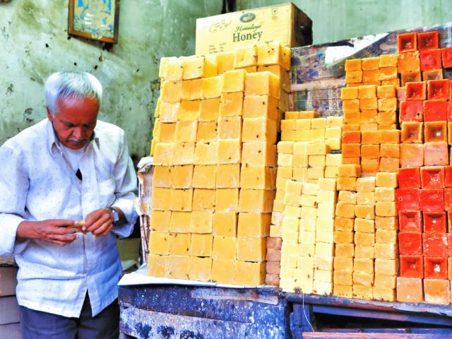 Honey-merchant-at-local-markets-in-Mysore-India